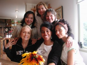 Hedgebrook alumnae in the farmhouse kitchen (clockwise, left to right): Gloria Steinem, Monique Truong, Holly Morris, Carolyn Forché, Suheir Hammad and Ruth Forman (circa 2008). Courtesy of Hedgebrook archives.