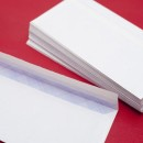 Pile of blank white envelopes