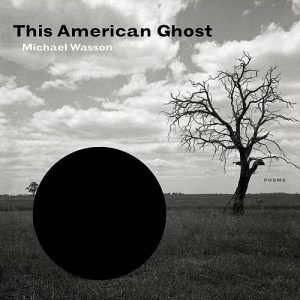 Cover for Michael Wasson's book This American Ghost, a black and white photograph of a bright sky with a few clouds, a barren tree in the middle an to the right, and a large, black circle in the foreground to the left of the tree.